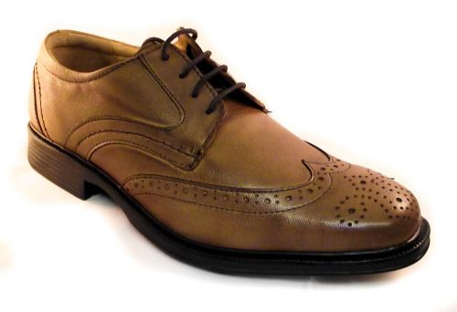 Leather Brogue in tan with comfort footbed and flexible rubber sole.